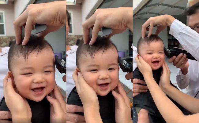 Chẳng sợ hãi khóc lóc, cậu bé lại tươi cười hớn hở khi được cắt tóc khiến ai cũng vui lây - Ảnh 2.