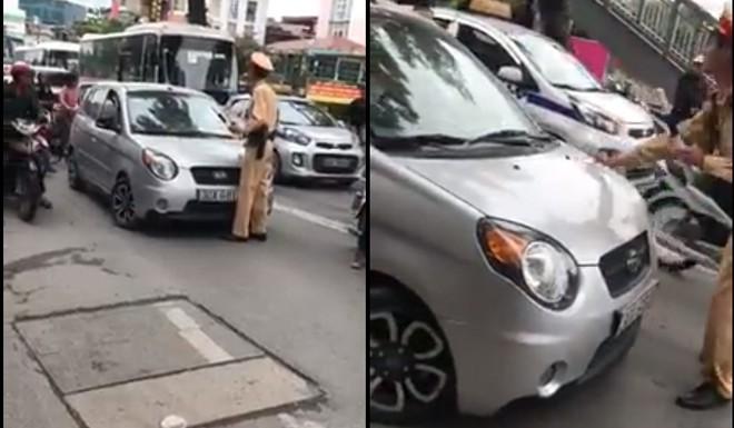 Hà Nội: CSGT yêu cầu dừng xe, nữ tài xế vẫn bình thản lái xe và nói Tôi đang bận, tý quay lại - Ảnh 2.