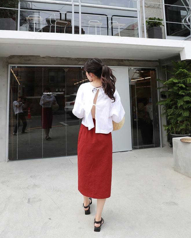Váy áo bây giờ mốt là phải mịn ở đằng trước, đằng sau đan dây buộc nơ tung xòe - Ảnh 10.
