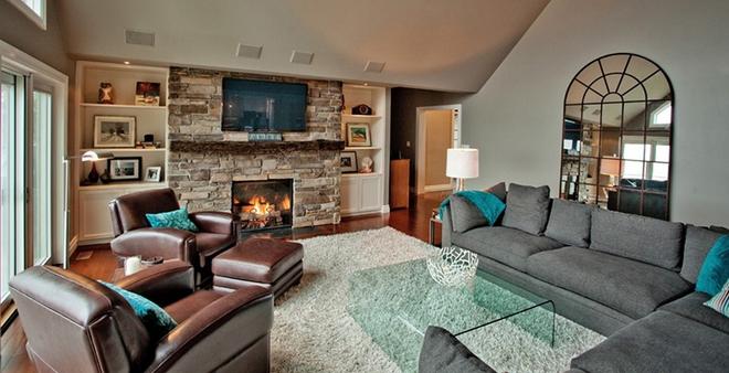 Gợi ý 20 kiểu ghế da màu nâu trang trí phòng khách không bao giờ lỗi mốt - Ảnh 1.