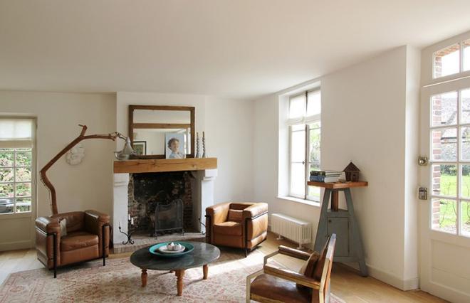 Gợi ý 20 kiểu ghế da màu nâu trang trí phòng khách không bao giờ lỗi mốt - Ảnh 15.