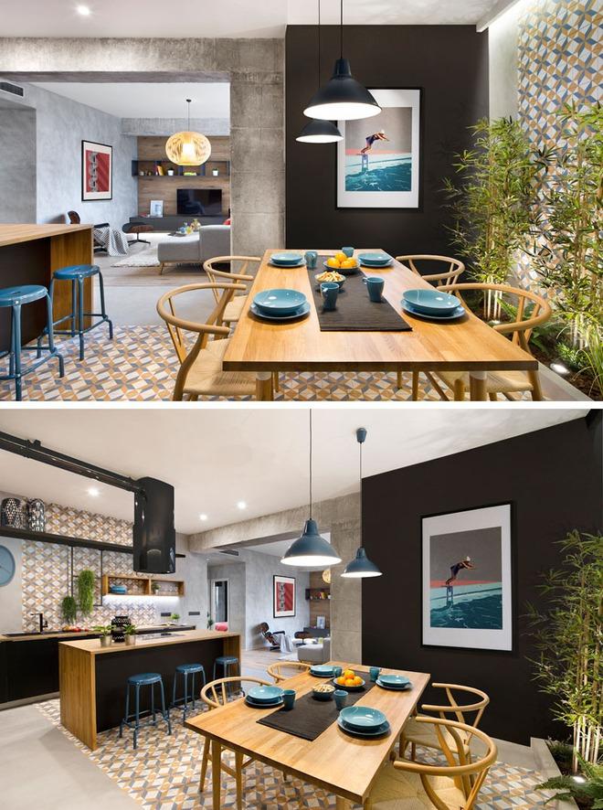 Chiêm ngưỡng căn hộ đầy lôi cuốn nhờ sự kết hợp ấn tượng của bê tông, gỗ, gạch ốp và màu đen - Ảnh 1.