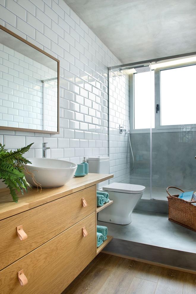 Chiêm ngưỡng căn hộ đầy lôi cuốn nhờ sự kết hợp ấn tượng của bê tông, gỗ, gạch ốp và màu đen - Ảnh 6.