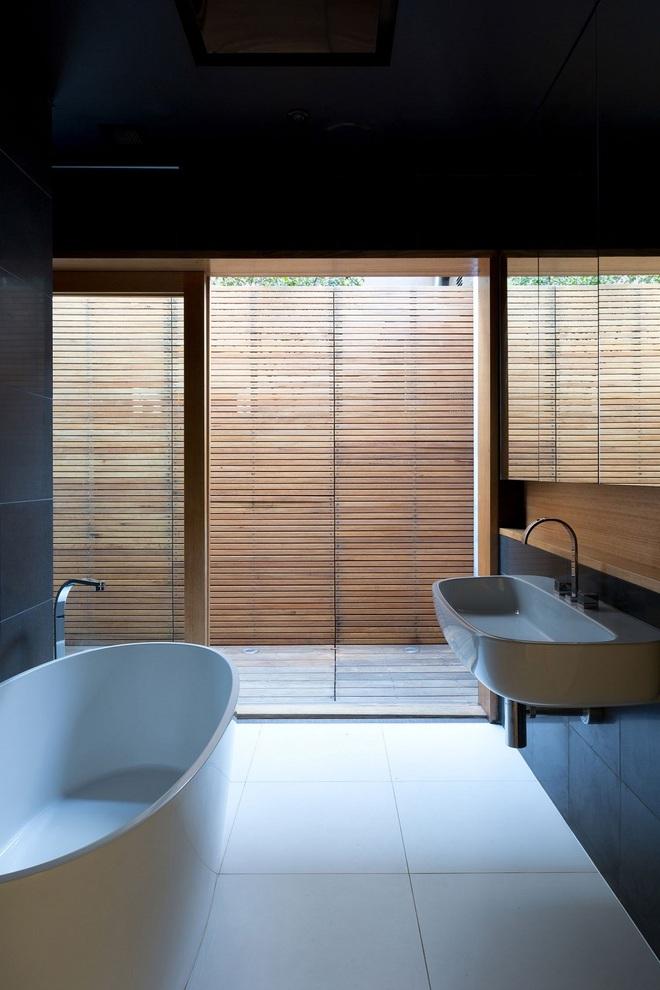 Ngôi nhà đặc biệt có không gian mở kết nối với thiên nhiên, nội thất tối giản nhưng vô cùng hiện đại - Ảnh 10.