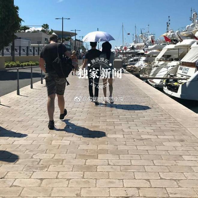 Lộ clip Phạm Băng Băng - Lý Thần nắm tay nô đùa tình tứ trên bãi biển - Ảnh 2.