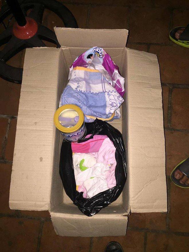 Hà Nội: Bé gái khoảng 5 tháng tuổi bị bỏ rơi trong thùng carton cùng quần áo, bỉm sữa 3