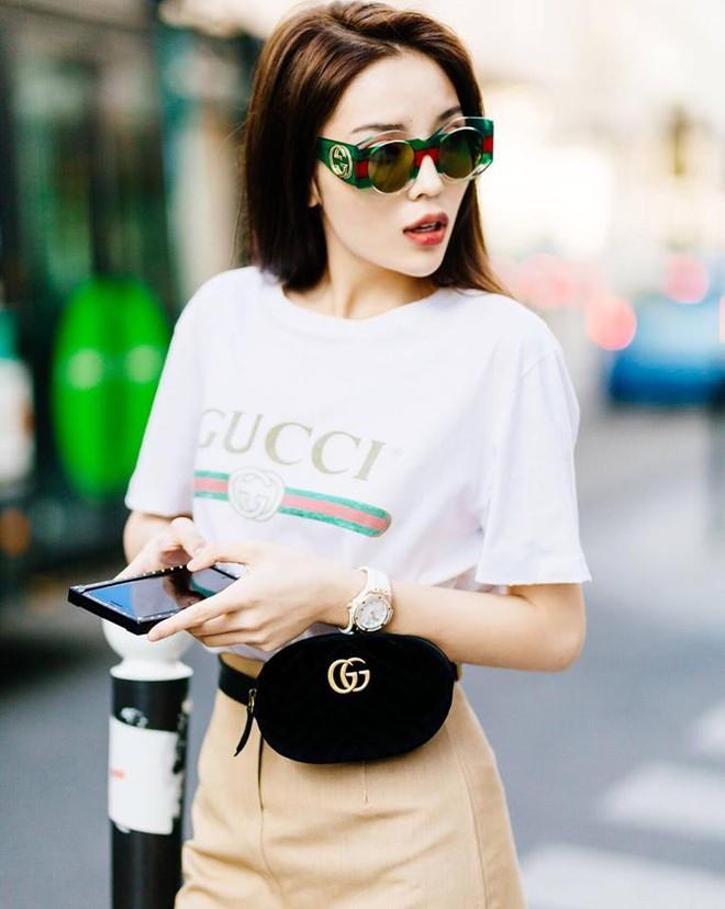 Chiếc túi nhỏ bé lại đang là món đồ đụng hàng lia lịa trong street style của phái đẹp Việt - Ảnh 12.
