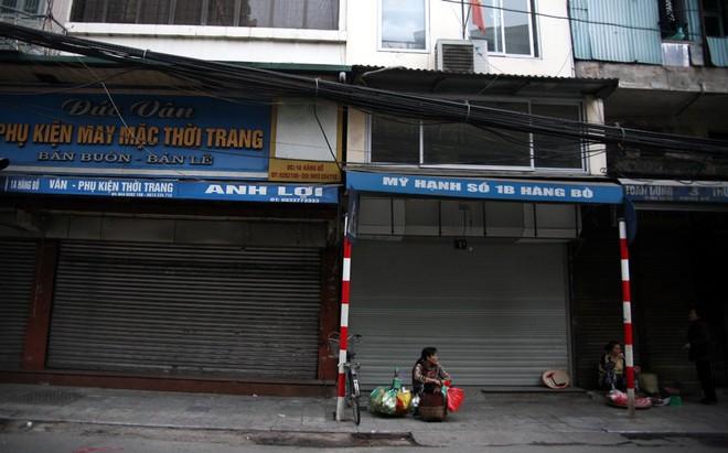 Sáng 29 Tết, nhiều tuyến phố Hà Nội đã vắng bóng người qua lại - Ảnh 4.