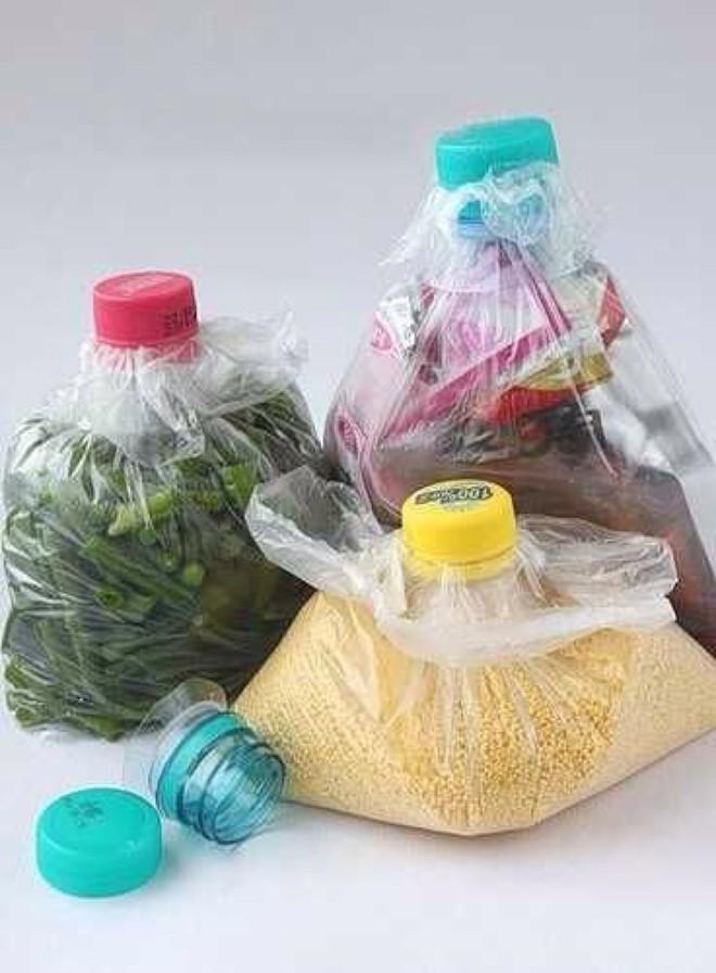 Muôn vàn cách tái chế đồ dùng độc đáo, hay ho từ chai nhựa bỏ đi - Ảnh 2.