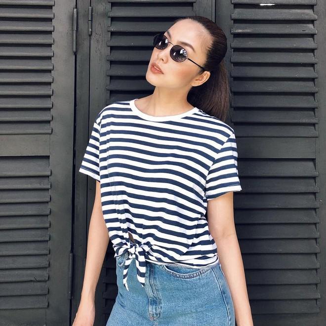 Chỉ với áo phông kẻ và quần jeans, một mình Hà Tăng cân cả street style sao Việt tuần này - Ảnh 1.