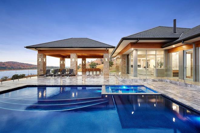 Những ngôi nhà sở hữu bể bơi ngoài trời đẹp đến lịm tim - Ảnh 15.