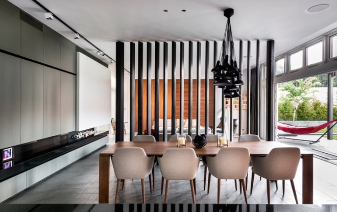 Sử dụng vách ngăn bằng đồ nội thất hoặc đồ trang trí đang là xu hướng mới để tạo không gian mở cho ngôi nhà - Ảnh 13.