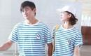 Ngô Kỳ Long ngọt ngào nắm chặt tay vợ ở sân bay sau tin đồn ly hôn vì Lưu Thi Thi ngoại tình