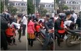 """Cô gái bị kéo tuột váy vì nhóm thanh niên đi """"bắt vợ"""" tại trung tâm chợ thị trấn Phù Yên"""