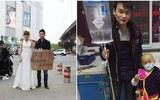 Trung Quốc: Người phụ nữ trẻ mặc váy cô dâu đứng giữa đường, chồng ở bên cạnh giơ biển