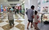 Xúc động cảnh người cha thô kệch tay cầm túi sữa tay bế con gái xộc xệch trên vai trong siêu thị