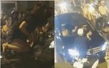 Đánh ghen náo loạn ở Hà Nội: Người phụ nữ leo lên nắp capo, đập vỡ kính xe Mercedes