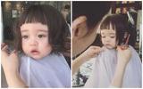 Mắt ngân ngấn nước vì bị cắt tóc, bé gái đáng yêu gây sốt khắp châu Á