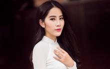Hoa khôi Nam Em khoe vóc dáng nuột nà trong áo dài truyền thống