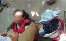 Người phụ nữ bị dân vây bắt, dí dao vào cổ dọa giết vì nghi bắt cóc trẻ em