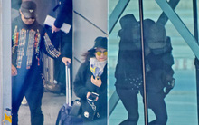 Vợ chồng Chương Tử Di cùng con gái đi xe bus từ sân bay về thành phố