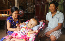 Phép màu kỳ diệu đến với cặp vợ chồng trẻ nuôi con gái 4 tuổi bị não úng thủy, đầu to gấp 3 lần trong năm mới