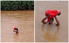 Hình ảnh người cha nghèo vượt lũ dữ đưa con đi chữa bệnh khiến hàng triệu người rơi lệ