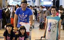 Bình Minh hộ tống bà xã đại gia và con gái sau chuyến bay dài