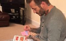David Beckham thêu váy búp bê cho con gái cưng