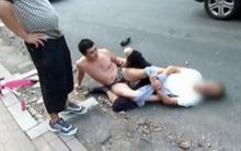 Va chạm giao thông, thầy giáo bị lột hết quần áo giữa đường