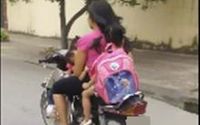 Clip: Người mẹ chạy xe máy bằng một tay, một tay bế con bú khiến người đi đường sợ hãi