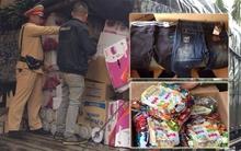 Bắt xe tải chứa hàng loạt bánh kẹo, nhãn hàng thời trang không rõ nguồn gốc