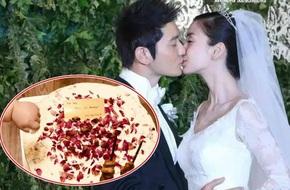 Huỳnh Hiểu Minh khoe ảnh con trai bốc trộm bánh kỷ niệm 2 năm ngày cưới