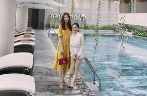 Hoa hậu Đặng Thu Thảo xuất hiện xinh đẹp với váy rộng và dép bệt