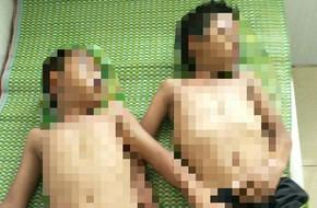 Gia đình bàng hoàng phát hiện xác 2 con trai chìm dưới đáy đập nước