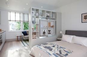 Sử dụng vách ngăn bằng đồ nội thất hoặc đồ trang trí đang là xu hướng mới để tạo không gian mở cho ngôi nhà
