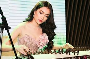 Á hậu Lệ Hằng gây bất ngờ khi chơi đàn tranh trước ngày dự thi Hoa hậu Hoàn vũ 2016