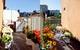 Ngắm căn hộ nhỏ góc nào cũng xinh bên ban công rực rỡ hoa và nắng