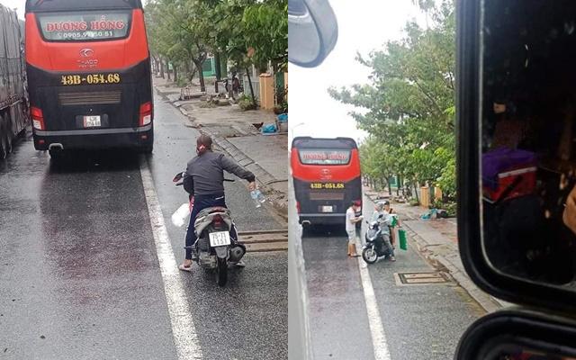 Ấm lòng cảnh người dân Huế dù cũng đang chịu ảnh hưởng bão số 9 vẫn gõ cửa từng chiếc trong đoàn xe xếp hàng trú bão để phát cơm, nước uống miễn phí