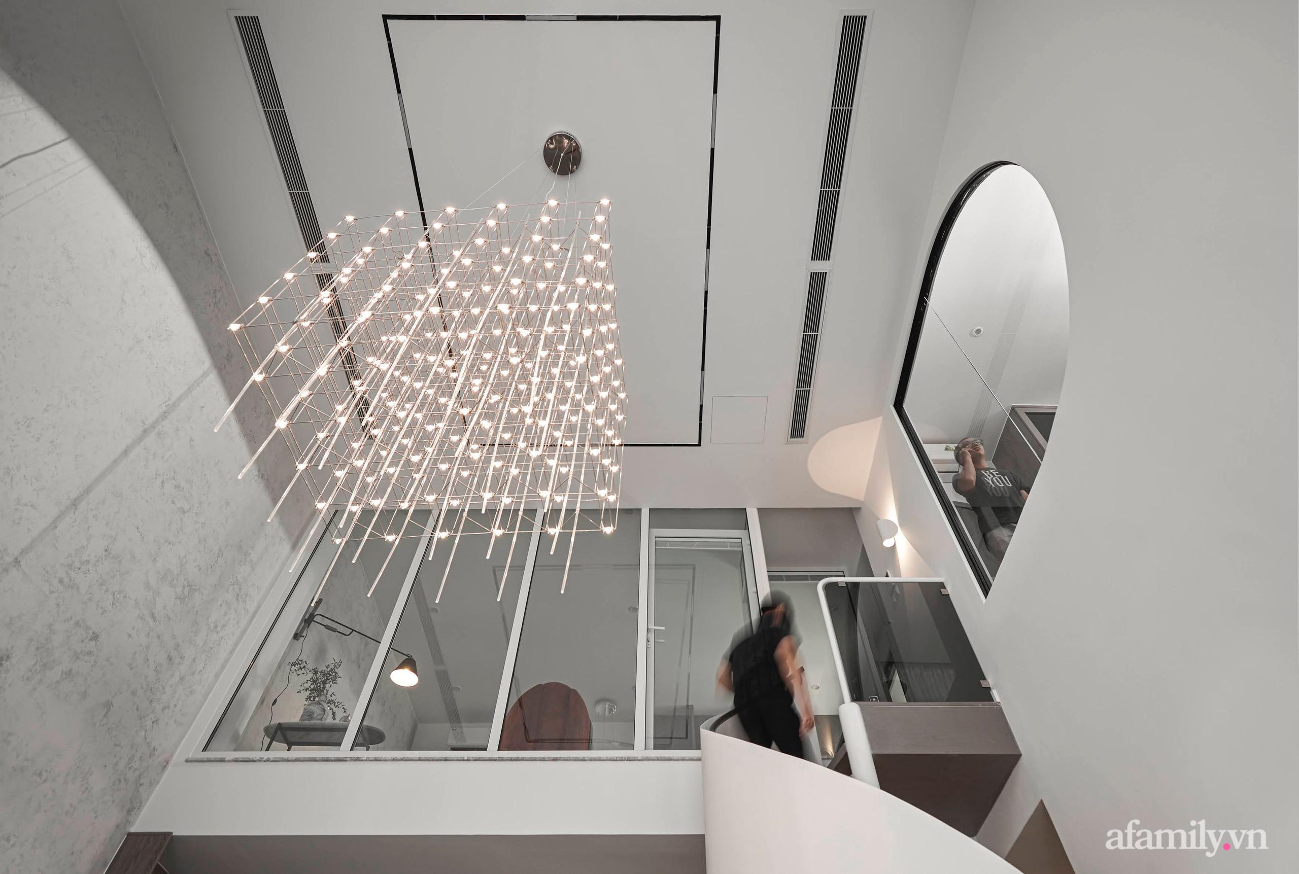 Căn hộ 2 tầng rộng 145m² đẹp sang trọng với điểm nhấn mộc mạc từ chất liệu bê tông ở Sài Gòn - Ảnh 6.