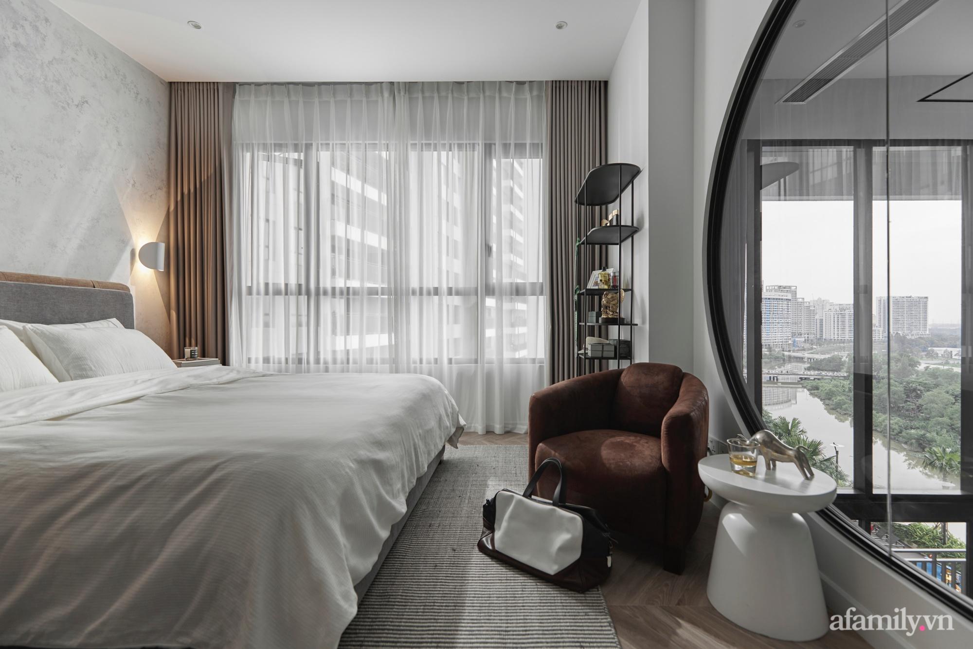 Căn hộ 2 tầng rộng 145m² đẹp sang trọng với điểm nhấn mộc mạc từ chất liệu bê tông ở Sài Gòn - Ảnh 14.