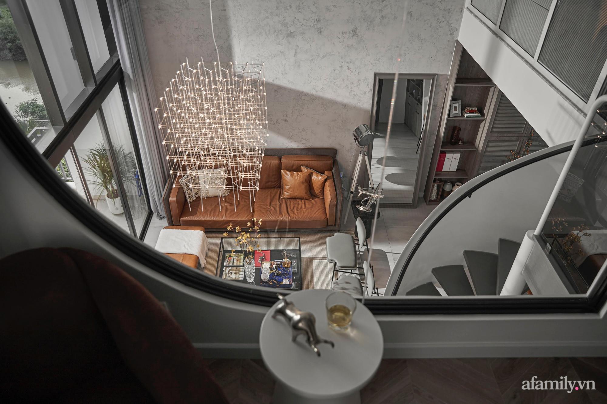 Căn hộ 2 tầng rộng 145m² đẹp sang trọng với điểm nhấn mộc mạc từ chất liệu bê tông ở Sài Gòn - Ảnh 11.