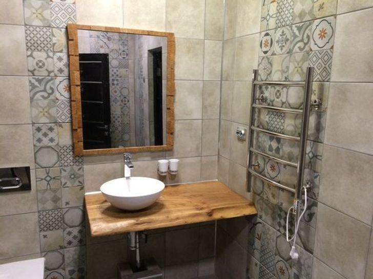 Những mẹo đơn giản dễ làm biến phòng tắm tẻ nhạt thành không gian thư giãn ở khách sạn sang chảnh - Ảnh 10.