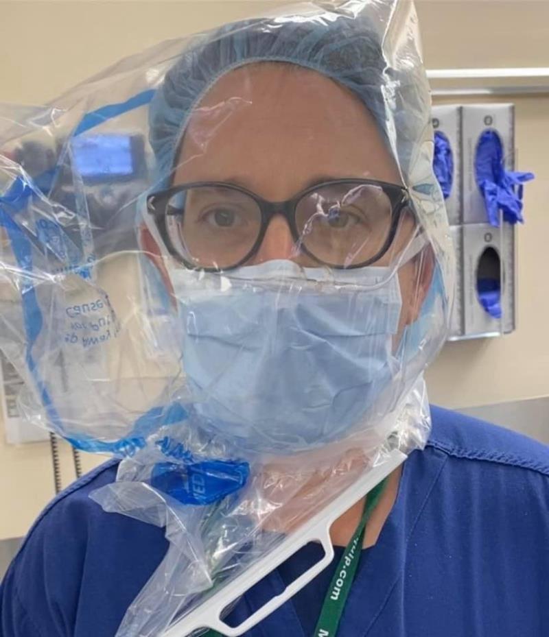 Thiếu vật tư y tế, bệnh viện ở Mỹ khử khuẩn, tái sử dụng khẩu trang N95 - Ảnh 5.