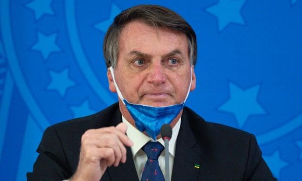 """Bất chấp sự thật hàng ngàn người tử vong, Tổng thống Brazil nói Covid-19 """"chỉ là trò bịp bợm của truyền thông"""" - Ảnh 1."""