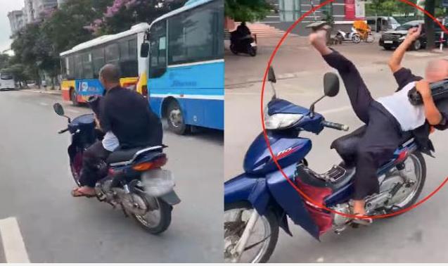 Ông già 62 tuổi buông 2 tay, phóng xe vèo vèo ở Hà Nội bị triệu tập, phạt 8,25 triệu đồng - Ảnh 1.