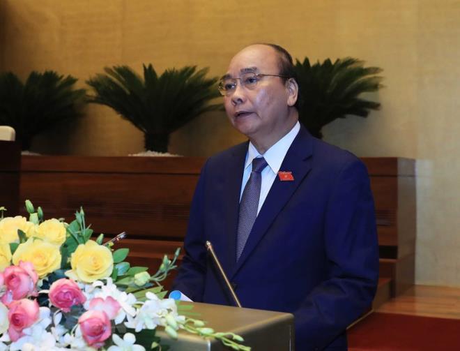 Thủ tướng đề nghị Quốc hội hoãn tăng lương - Ảnh 1.