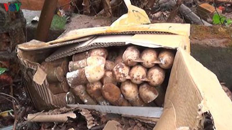 Đào móng làm hồ chứa nước, phát hiện hơn 60 quả đạn pháo ở Bình Phước - Ảnh 1.