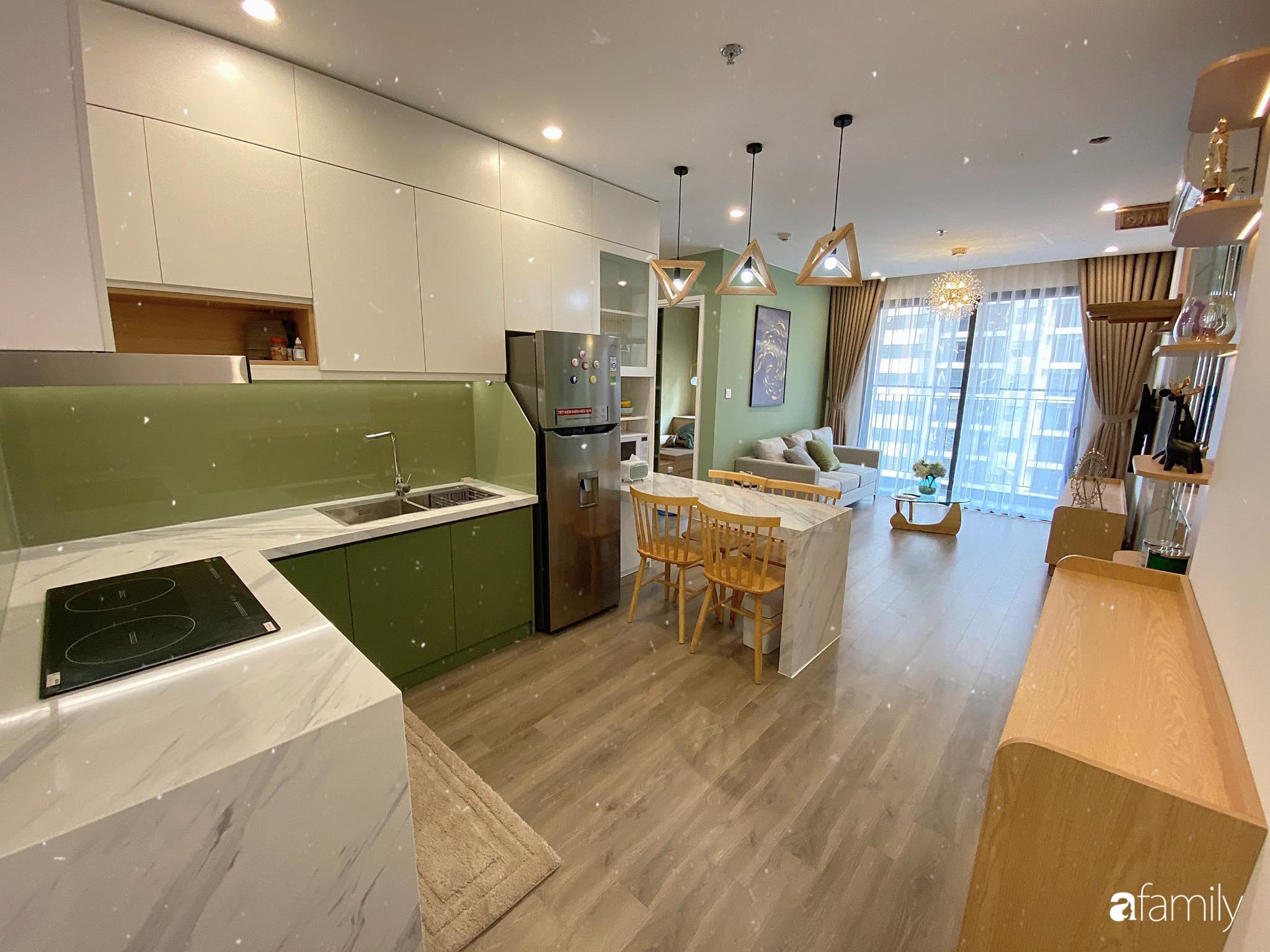 Căn hộ 59m² màu xanh lá xua tan nóng bức mùa hè có chi phí hoàn thiện 225 triệu đồng ở Hà Nội - Ảnh 2.