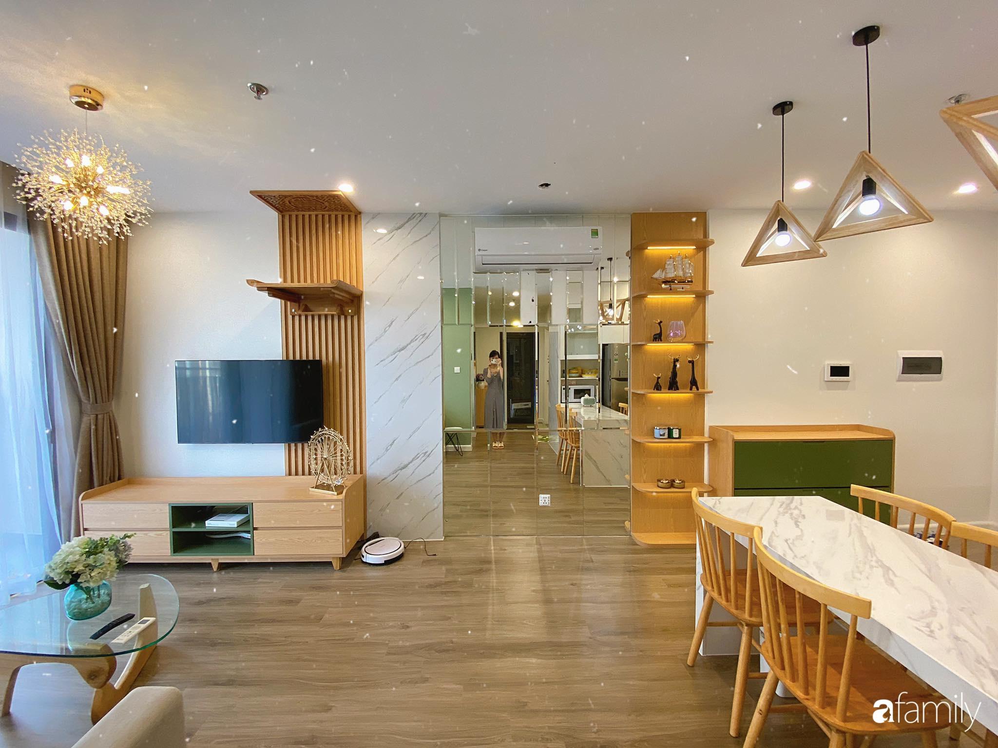 Căn hộ 59m² màu xanh lá xua tan nóng bức mùa hè có chi phí hoàn thiện 225 triệu đồng ở Hà Nội - Ảnh 1.